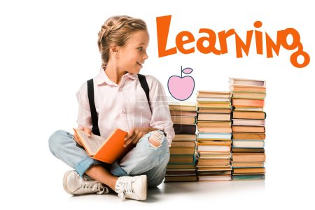 Photo pour Happy kid holding book near learning letters on white - image libre de droit