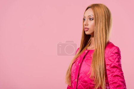 Photo for Beautiful, stylish african american woman looking away isolated on pink, fashion doll concept - Royalty Free Image