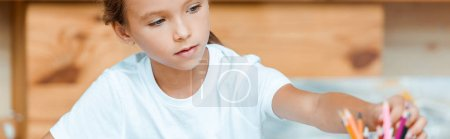 Photo for Panoramic shot of cute kid taking color pencils - Royalty Free Image