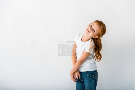 Photo for Happy redhead kid looking at camera on white - Royalty Free Image