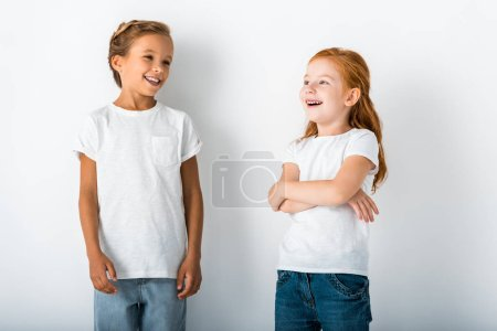 Photo for Cheerful kids standing and smiling on white - Royalty Free Image