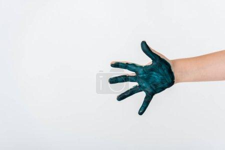Photo pour Crochet vue d'un enfant avec de la peinture bleue à la main isolé sur blanc - image libre de droit