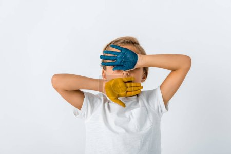 kid with paint on hands covering face isolated on white