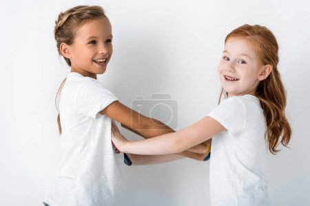 Photo for Cheerful kids smiling standing standing on white - Royalty Free Image