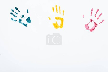 Photo for Blue, yellow and red hand prints on white - Royalty Free Image