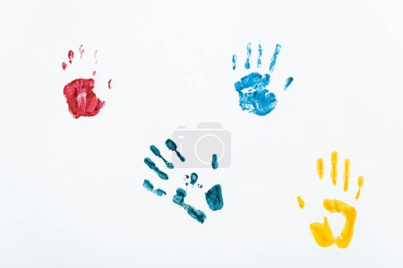 Photo for Yellow, blue and red hand prints on white - Royalty Free Image