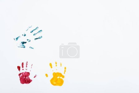 Photo for Yellow, red and blue hand prints on white - Royalty Free Image