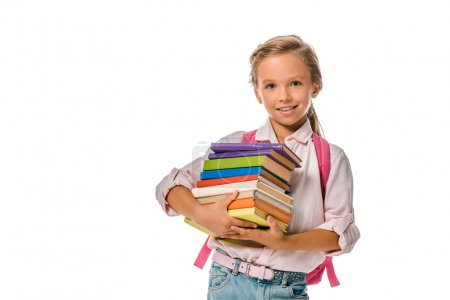 Photo for Happy schoolkid holding colorful books isolated on white - Royalty Free Image