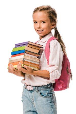 Photo pour Un écolier souriant tenant des livres colorés isolés sur du blanc - image libre de droit