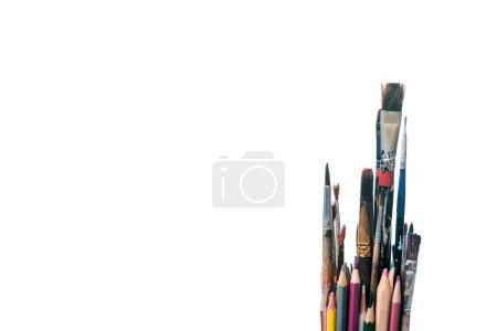 Photo for Colorful pencils near paintbrushes isolated on white - Royalty Free Image