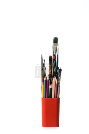 Photo for Pen holder with colorful pencils and paintbrushes isolated on white - Royalty Free Image