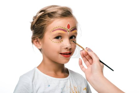 Photo pour Cropping view of woman holding paintbrush near happy kid with face painting isolated on white - image libre de droit