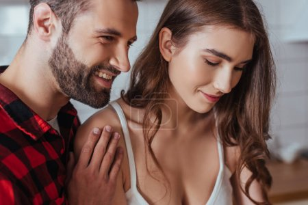 Photo for Happy young man touching shoulder of beautiful, smiling girlfriend - Royalty Free Image