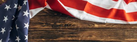horizontal image of american flag with stars and stripes on wooden surface