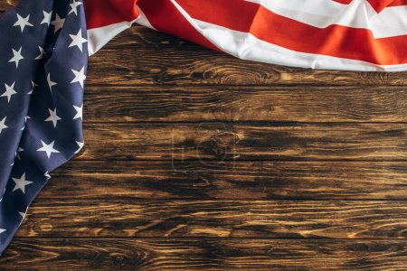 Photo for Top view of american flag with stars and stripes on wooden surface - Royalty Free Image