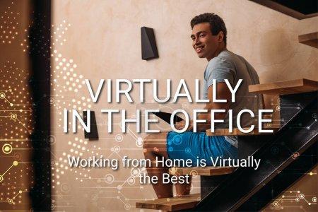 Photo pour Heureux homme de race mixte en utilisant un ordinateur portable sur les escaliers près de pratiquement dans le bureau, travailler à la maison est pratiquement le meilleur lettrage - image libre de droit