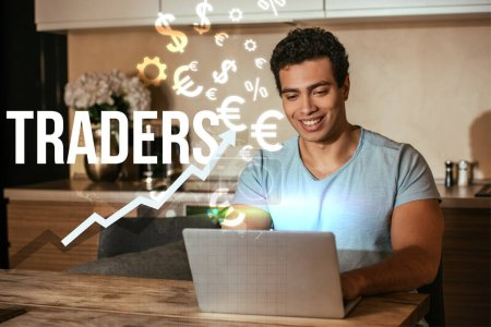 Photo for Cheerful mixed race freelancer using laptop near traders lettering and money signs - Royalty Free Image