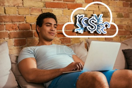 Photo for Young bi-racial man chilling with laptop on sofa near cloud with money signs illustration - Royalty Free Image