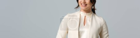 Photo for Panoramic crop of smiling businesswoman isolated on grey - Royalty Free Image
