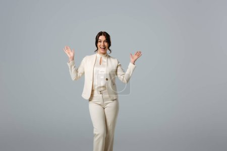 Photo for Cheerful businesswoman pointing with hands isolated on grey, concept of body positive - Royalty Free Image