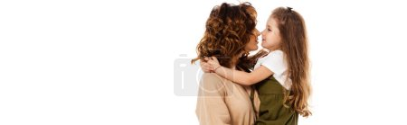 Photo for Horizontal image of cheerful kid hugging happy and curly mother isolated on white - Royalty Free Image