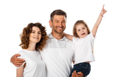 Photo for Happy father holding in arms cute daughter pointing with finger near curly wife isolated on white - Royalty Free Image