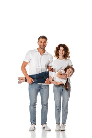 Photo for Happy mother and father holding in arms cute kid on white - Royalty Free Image