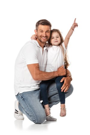 Photo for Happy daughter sitting on father and pointing with finger on white - Royalty Free Image