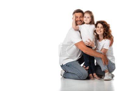 Photo pour Heureux enfant étreignant père près de joyeuse mère sur blanc - image libre de droit
