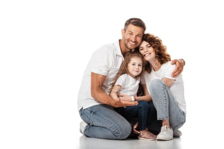 Photo for Happy man hugging cheerful wife and daughter on white - Royalty Free Image