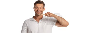 Photo for Panoramic orientation of cheerful man holding toothbrush while brushing teeth isolated on white - Royalty Free Image
