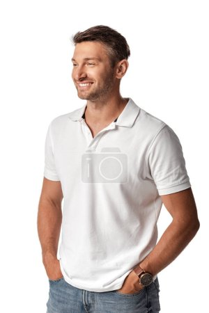 happy man in white t-shirt standing with hands in pockets isolated on white