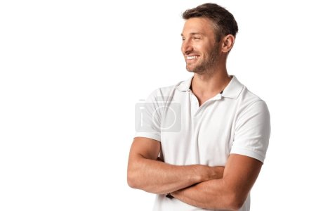 happy man in white t-shirt standing with crossed arms isolated on white