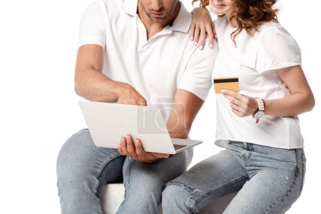 Photo for Cropped view of happy woman holding credit card near man with laptop isolated on white - Royalty Free Image