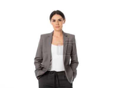 Photo pour Femme d'affaires debout avec les mains dans des poches isolées sur blanc - image libre de droit