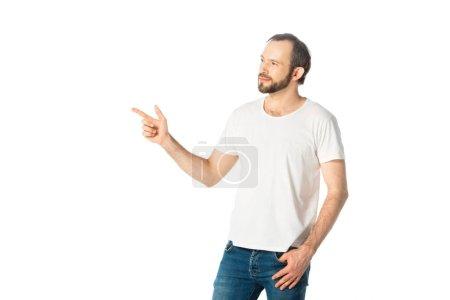 Photo pour Vue de face de l'homme souriant pointant du doigt isolé sur blanc - image libre de droit
