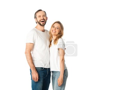 Photo for Happy adult couple in white t-shirts embracing isolated on white - Royalty Free Image