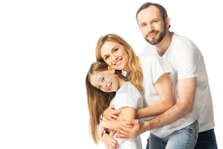 Photo for Happy family in white t-shirts hugging isolated on white - Royalty Free Image