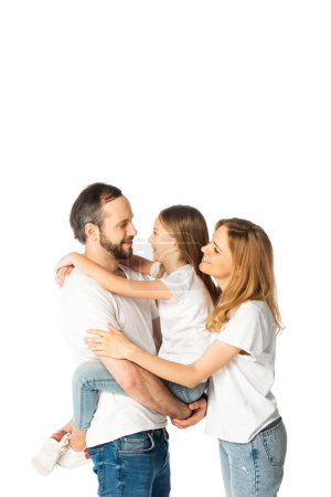 Photo for Smiling family in white t-shirts hugging isolated on white - Royalty Free Image