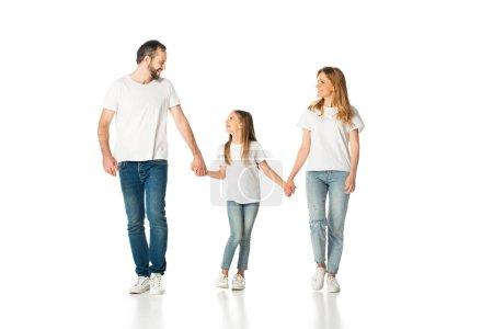 Photo pour Heureux casual famille tenant la main tout en marchant isolé sur blanc - image libre de droit