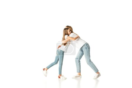 happy daughter hugging mother isolated on white