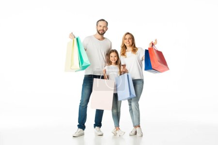 Photo for Cheerful family with colorful shopping bags isolated on white - Royalty Free Image