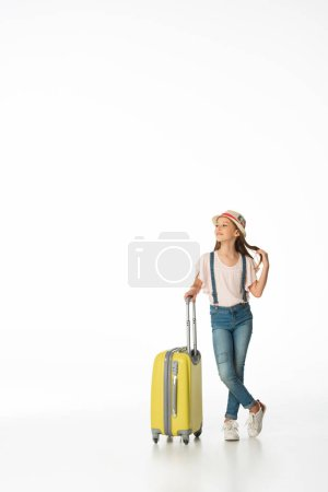 Photo for Dreamy girl in hat with yellow travel bag isolated on white - Royalty Free Image