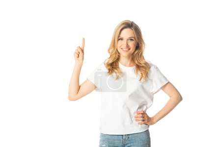 smiling attractive adult woman pointing up isolated on white