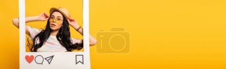 brunette girl in summer outfit posing in social network frame on yellow background, panoramic shot