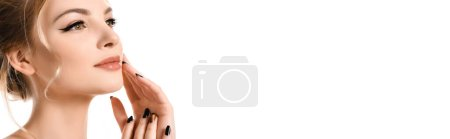 Photo for Beautiful blonde woman with makeup and black nails touching face isolated on white, panoramic shot - Royalty Free Image