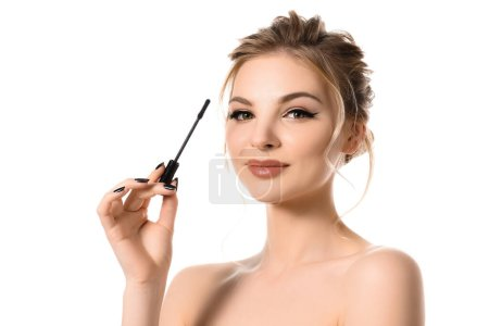 Photo for Naked beautiful blonde woman with makeup and black nails holding mascara isolated on white - Royalty Free Image