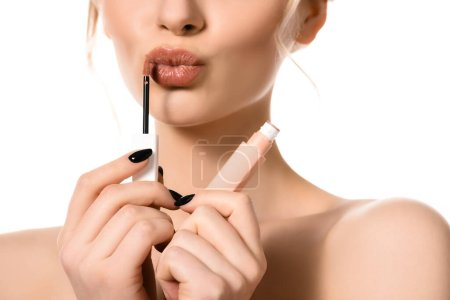 Photo for Cropped view of naked beautiful woman applying beige lip gloss isolated on white - Royalty Free Image