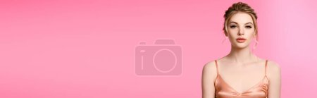Photo for Elegant beautiful blonde woman in silk dress isolated on pink, panoramic shot - Royalty Free Image