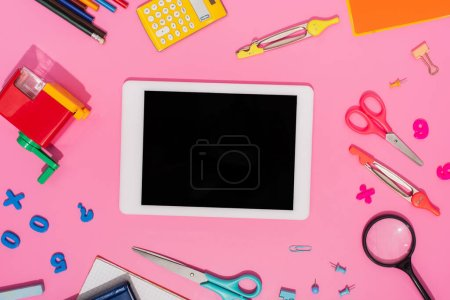 Photo for Top view of digital tablet with blank screen near school stationery on pink - Royalty Free Image
